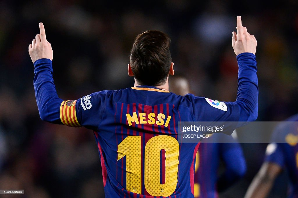 TOPSHOT - Barcelona's Argentinian forward Lionel Messi celebrates after scoring a goal during the Spanish league football match between Barcelona and Leganes at the Camp Nou stadium in Barcelona on April 7, 2018. / AFP PHOTO / Josep LAGO