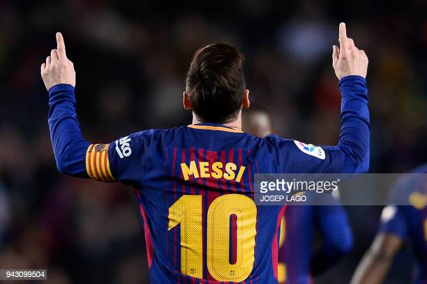 TOPSHOT Barcelona's Argentinian forward Lionel Messi celebrates after scoring a goal during the Spanish league football match between Barcelona and...