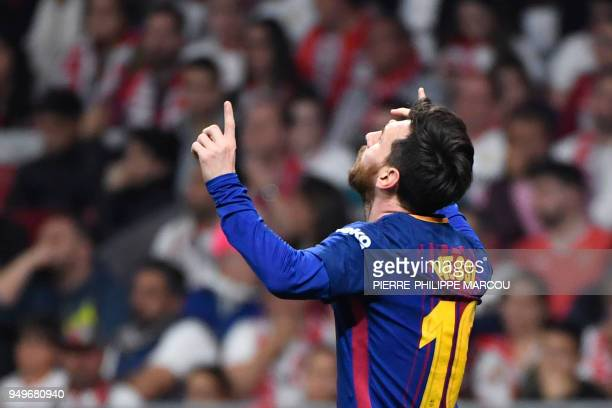 Barcelona's Argentinian forward Lionel Messi celebrates after scoring during the Spanish Copa del Rey final football match Sevilla FC against FC...