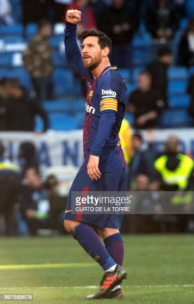 Barcelona's Argentinian forward Lionel Messi celebrates at the end of the Spanish League 'Clasico' football match Real Madrid CF vs FC Barcelona at...