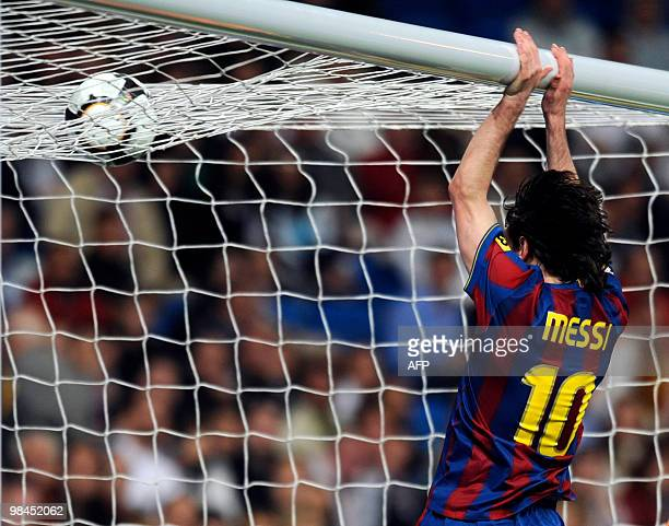 Barcelona's Argentinian forward Lionel Messi celebrates during the 'El Clasico' Spanish League football match Real Madrid against Barcelona at the...