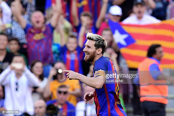 Barcelona's Argentinian forward Lionel Messi celebrates during the Spanish league football match FC Barcelona vs RC Deportivo de la Coruna at the...