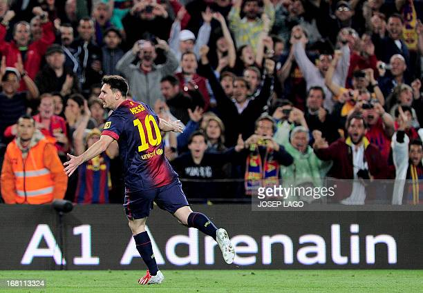 Barcelona's Argentinian forward Lionel Messi celebrates his first goal during the Spanish league football match FC Barcelona vs Real Betis at the...
