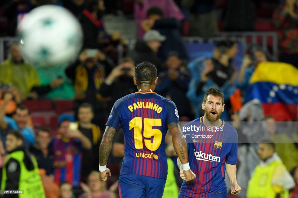 Barcelona's Argentinian forward Lionel Messi (R) celebrates his goal number 100 in a European competition during the UEFA Champions League group D football match FC Barcelona vs Olympiacos FC at the Camp Nou stadium in Barcelona on Ocotber 18, 2017. /