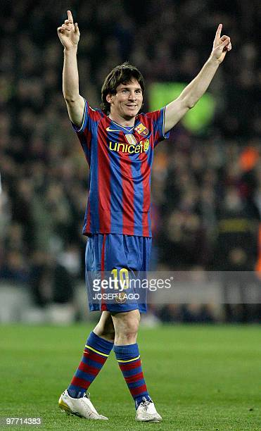 Barcelona's Argentinian forward Lionel Messi celebrates his goal during a Spanish League football match against Valencia at the Camp Nou Stadium in...