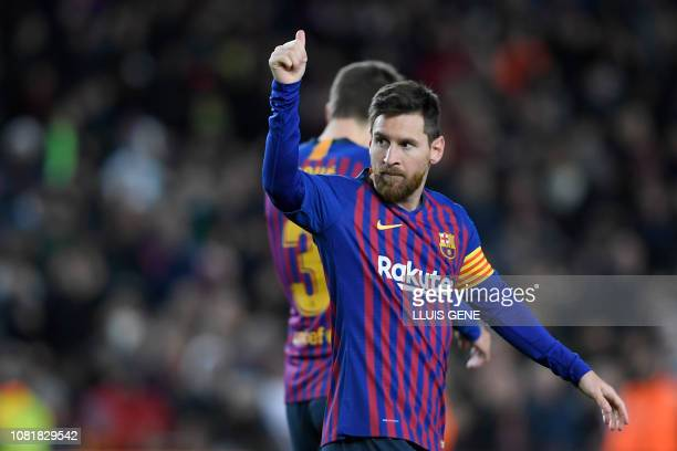 Barcelona's Argentinian forward Lionel Messi celebrates his goal during the Spanish League football match between FC Barcelona and SD Eibar at the...