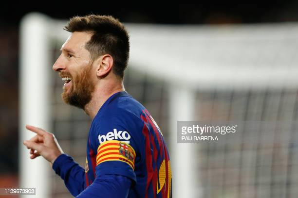 Barcelona's Argentinian forward Lionel Messi celebrates his goal during the Spanish League football match between FC Barcelona and Levante UD at the...