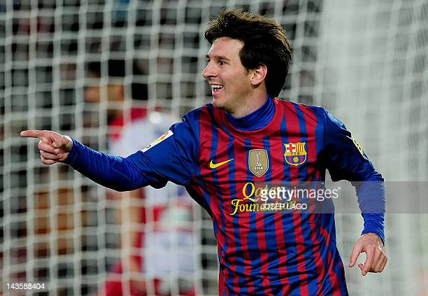 Barcelona's Argentinian forward Lionel Messi celebrates his goal during the Spanish league football match FC Barcelona vs Granada CF on March 20 2012...