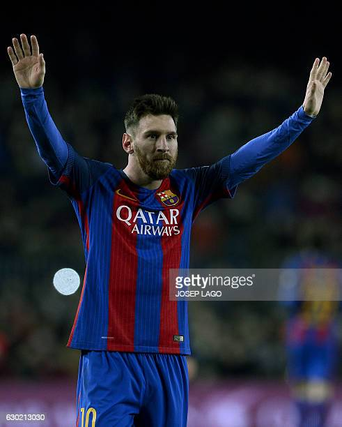 Barcelona's Argentinian forward Lionel Messi celebrates his goal during the Spanish league football match FC Barcelona vs RCD Espanyol at the Camp...