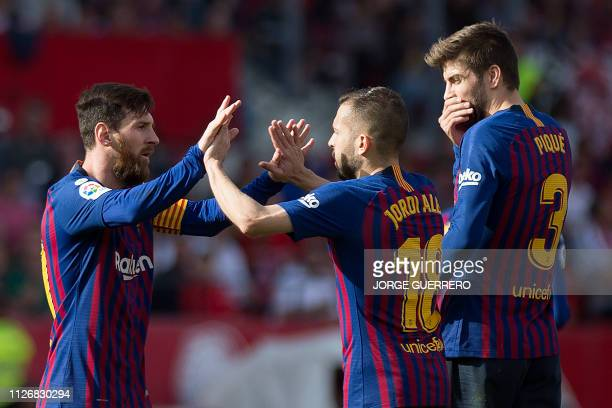 Barcelona's Argentinian forward Lionel Messi celebrates his goal with Barcelona's Spanish defender Jordi Alba beside Barcelona's Spanish defender...