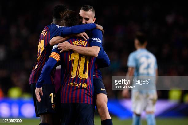 Barcelona's Argentinian forward Lionel Messi celebrates scoring a goal during the Spanish League football match between FC Barcelona and RC Celta de...