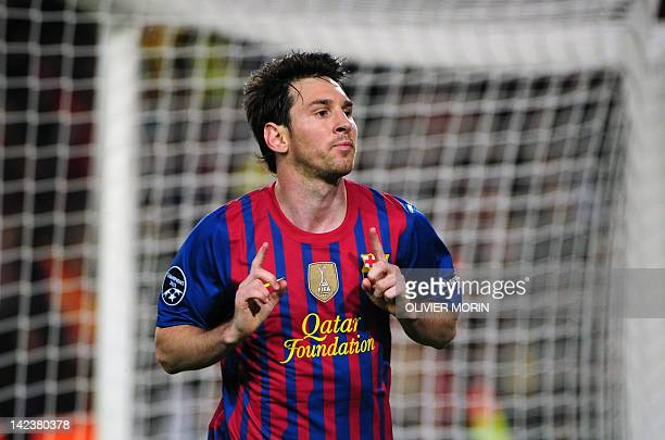 Barcelona's Argentinian forward Lionel Messi celebrates scoring his second penalty during the Champions League quarterfinal second leg football match...