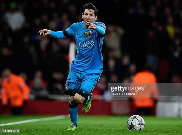 Barcelona's Argentinian forward Lionel Messi celebrates scoring his team's first goal during the UEFA Champions League round of 16 1st leg football...
