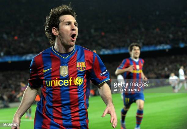 Barcelona's Argentinian forward Lionel Messi celebrates scoring his opening goal against Arsenal during the Champions League quarterfinal secondleg...