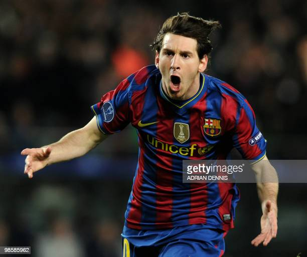 Barcelona's Argentinian forward Lionel Messi celebrates scoring his first goal against Arsenal during the Champions League quarterfinal secondleg...