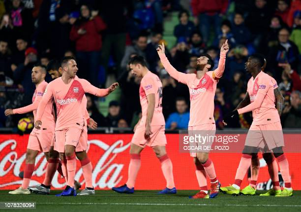 Barcelona's Argentinian forward Lionel Messi celebrates scoring the opener during the Spanish League football match between Getafe CF and FC...