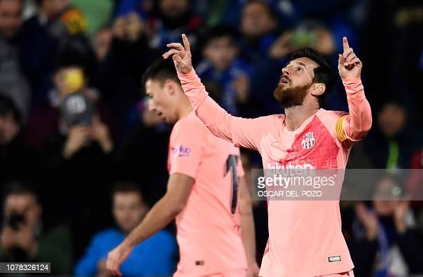 TOPSHOT Barcelona's Argentinian forward Lionel Messi celebrates scoring the opening goal during the Spanish League football match between Getafe CF...
