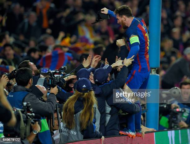 Barcelona's Argentinian forward Lionel Messi celebrates their victory at the end of the UEFA Champions League round of 16 second leg football match...