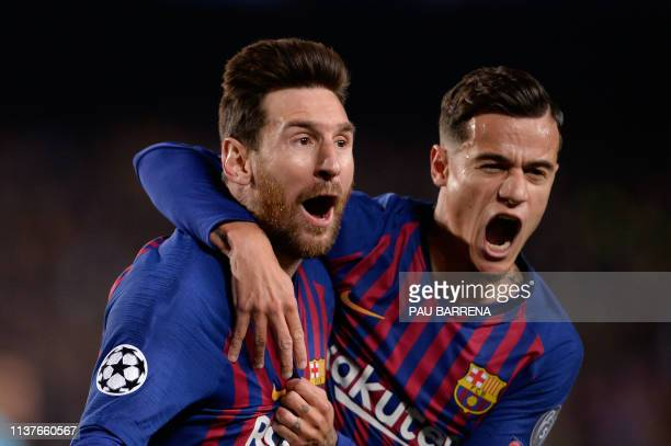 TOPSHOT Barcelona's Argentinian forward Lionel Messi celebrates with Barcelona's Brazilian midfielder Philippe Coutinho after scoring a goal during...