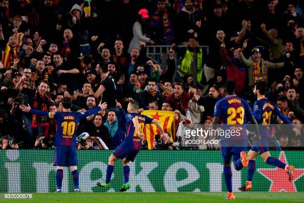 Barcelona's Argentinian forward Lionel Messi celebrates with supporters and teammates after scoring his team's third goal during the UEFA Champions...