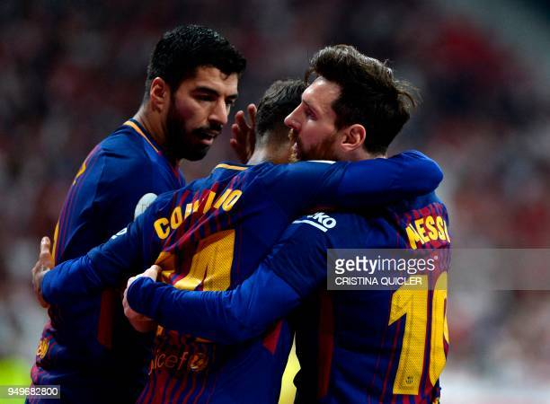 Barcelona's Argentinian forward Lionel Messi celebrates with Barcelona's Brazilian midfielder Philippe Coutinho and Barcelona's Uruguayan forward...