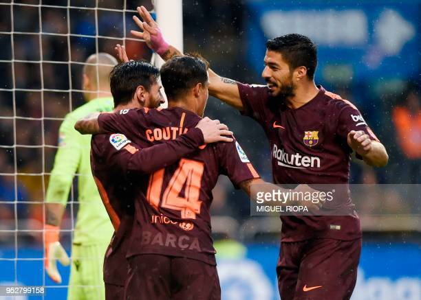 TOPSHOT Barcelona's Argentinian forward Lionel Messi celebrates with Barcelona's Brazilian midfielder Philippe Coutinho and Barcelona's Uruguayan...