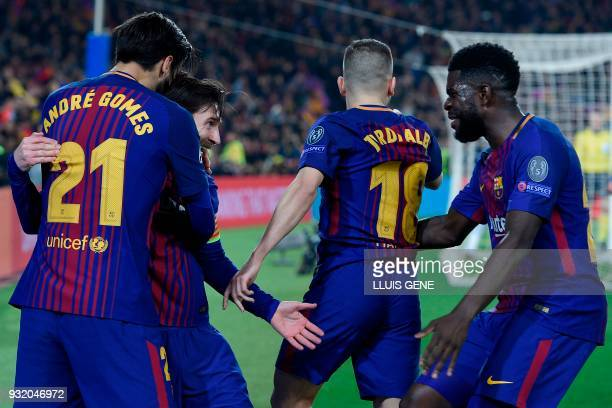 Barcelona's Argentinian forward Lionel Messi celebrates with Barcelona's Portuguese midfielder Andre Gomes Barcelona's French defender Samuel Umtiti...