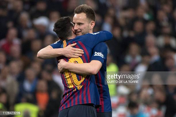 Barcelona's Argentinian forward Lionel Messi celebrates with Barcelona's Croatian midfielder Ivan Rakitic at the end of the Spanish league football...