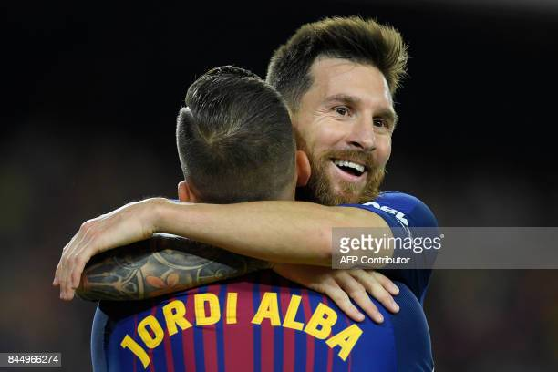 Barcelona's Argentinian forward Lionel Messi celebrates with Barcelona's defender Jordi Alba after scoring his second goal during the Spanish Liga...