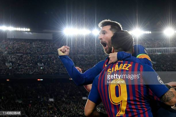 Barcelona's Argentinian forward Lionel Messi celebrates with Barcelona's Uruguayan forward Luis Suarez after scoring a goal during the UEFA Champions...