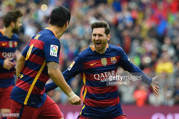 Barcelona's Argentinian forward Lionel Messi celebrates with Barcelona's Uruguayan forward Luis Suarez during the Spanish league football match FC...
