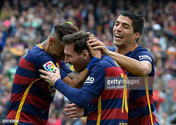 Barcelona's Argentinian forward Lionel Messi celebrates with Barcelona's Brazilian forward Neymar and Barcelona's Uruguayan forward Luis Suarez after...