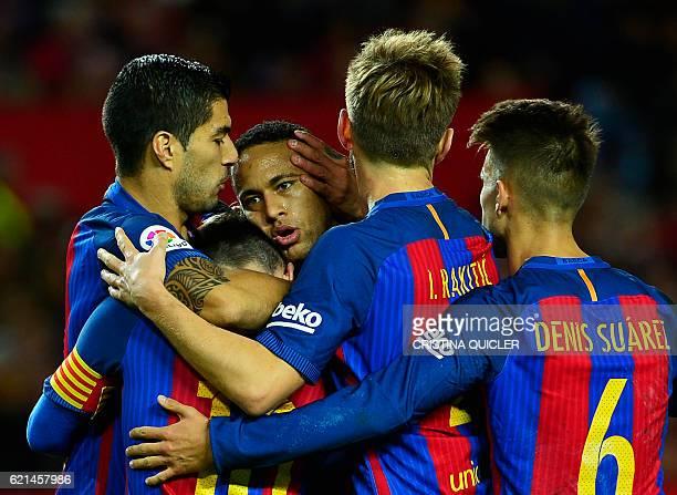 Barcelona's Argentinian forward Lionel Messi celebrates with Barcelona's Uruguayan forward Luis Suarez Barcelona's Brazilian forward Neymar and...