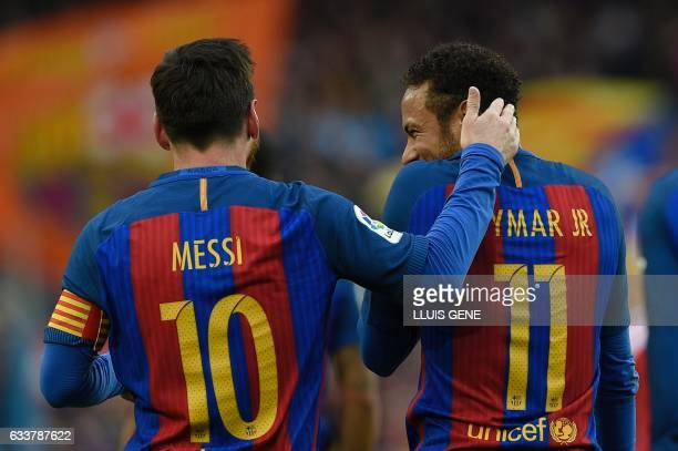 Barcelona's Argentinian forward Lionel Messi celebrates with Barcelona's Brazilian forward Neymar after scoring during the Spanish league football...