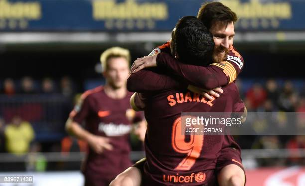 Barcelona's Argentinian forward Lionel Messi celebrates with Barcelona's Uruguayan forward Luis Suarez after scoring during the Spanish league...
