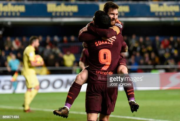 TOPSHOT Barcelona's Argentinian forward Lionel Messi celebrates with Barcelona's Uruguayan forward Luis Suarez after scoring during the Spanish...