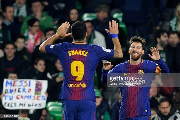TOPSHOT Barcelona's Argentinian forward Lionel Messi celebrates with Barcelona's Uruguayan forward Luis Suarez after scoring a goal during the...