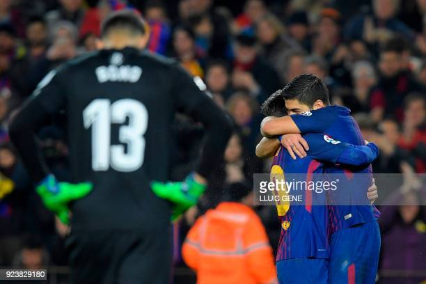 Barcelona's Argentinian forward Lionel Messi celebrates with Barcelona's Uruguayan forward Luis Suarez after scoring against Girona's Moroccan...