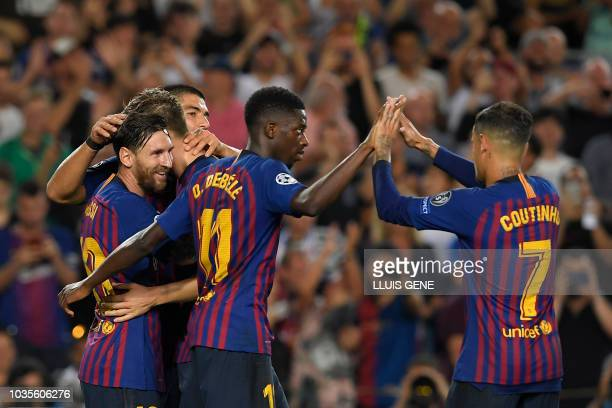 Barcelona's Argentinian forward Lionel Messi celebrates with Barcelona's French forward Ousmane Dembele and Barcelona's Brazilian midfielder Philippe...