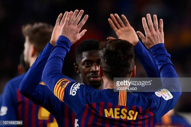 TOPSHOT Barcelona's Argentinian forward Lionel Messi celebrates with Barcelona's French forward Ousmane Dembele scoring a goal during the Spanish...