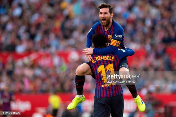 TOPSHOT Barcelona's Argentinian forward Lionel Messi celebrates with Barcelona's French forward Ousmane Dembele after scoring a goal during the...