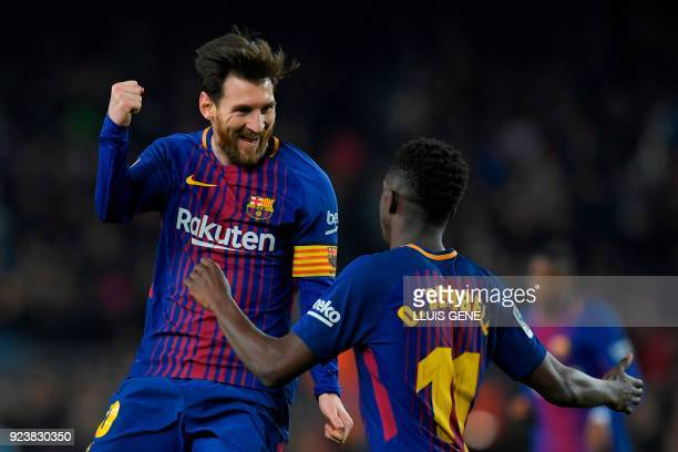 TOPSHOT Barcelona's Argentinian forward Lionel Messi celebrates with Barcelona's French forward Ousmane Dembele after scoring his second goal during...