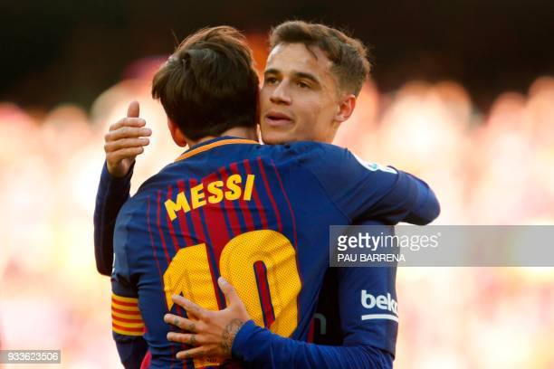 Barcelona's Argentinian forward Lionel Messi celebrates with Barcelona's Brazilian midfielder Philippe Coutinho after scoring during the Spanish...