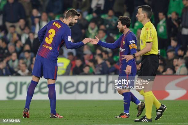 Barcelona's Argentinian forward Lionel Messi celebrates with Barcelona's Spanish defender Gerard Pique after scoring a goal during the Spanish league...