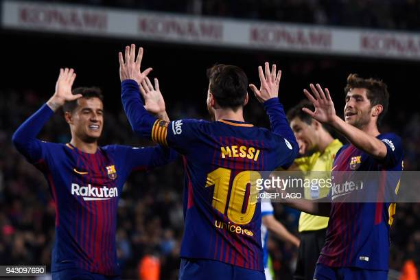 Barcelona's Argentinian forward Lionel Messi celebrates with Barcelona's Spanish midfielder Sergi Roberto and Barcelona's Brazilian midfielder...