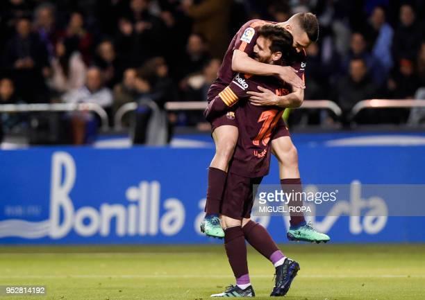 TOPSHOT Barcelona's Argentinian forward Lionel Messi celebrates with Barcelona's Spanish defender Jordi Alba after scoring a goal during the Spanish...