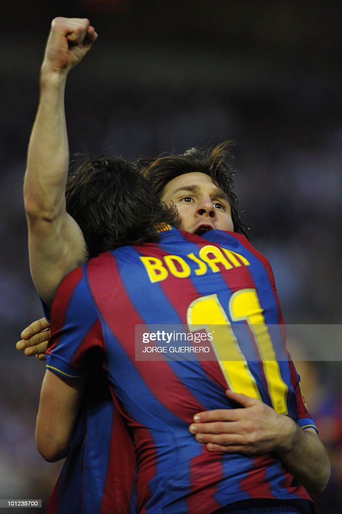 Barcelona's Argentinian forward Lionel Messi (R) celebrates with teammate Barcelona's forward Bojan Krkic after scoring against Sevilla during a Spanish league football match at Ramon Sanchez Pizjuan stadium on April 8, 2010.
