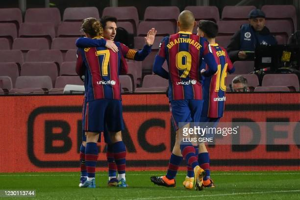 Barcelona's Argentinian forward Lionel Messi celebrates with teammates after scoring during the Spanish league football match between FC Barcelona...