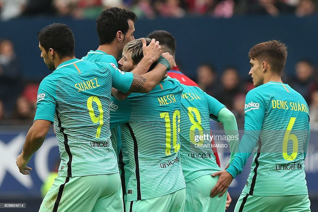 Barcelona's Argentinian forward Lionel Messi (3L) celebrates with teammates during the Spanish league football match CA Osasuna vs FC Barcelona at the Reyno de Navarra (El Sadar) stadium in Pamplona on December 10, 2016. / AFP / CESAR
