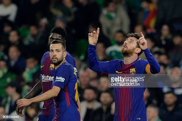 Barcelona's Argentinian forward Lionel Messi celebrates with teammates after scoring a goal during the Spanish league football match between Real...